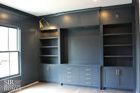 Home Office Built In Furniture Gray Home Office With Gray Built Ins And Brass Swing Arm Sconces