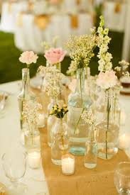 Backyard Rustic Wedding by Centerpieces Assorted Bottles And Jars Fall Rustic Backyard