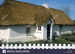 Thatched Cottage Ireland by Thatched Cottage With White Picket Fence Wexford Ireland Stock