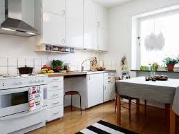 nice looking small kitchen with stripped rug and laminated wooden