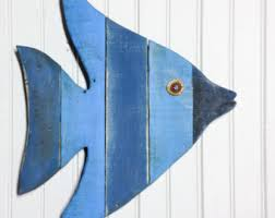 painted string of wooden fish wall decor made with repurposed