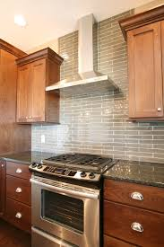 Stainless Steel Kitchen Backsplash Ideas Glasstile Extends All The Way To The Ceiling Behind This Chimney