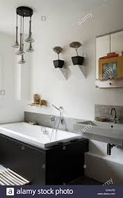 french retro pendant light fitting in modern white bathroom with