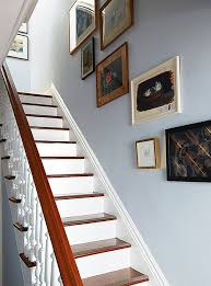 How To Paint A Banister Black These Expert Tips For How To Hang Art Will Transform Your Home