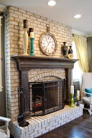 red brick fireplace with white mantel repainted for a cozy feel