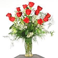 dozen roses in glass vase