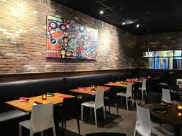interior colorful artistic wall painting on the brick wall design
