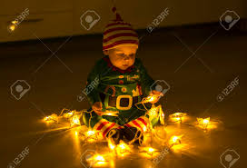 santa helper baby on the floor decomposes lights that