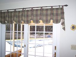 tab top valance with pleats at each tab and covered buttons top