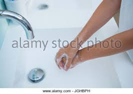 Standing Water In Bathtub Standing In Bathroom Washing Her Hands Stock Photo Royalty