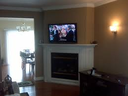 furniture corner tv mounted over white fireplace as well as