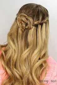 flower hair bun waterfall braid and flower bun