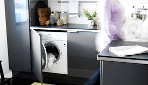 caser le lave linge dans la cuisine