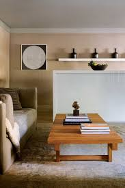 living room white floating shelf low varnished coffee table
