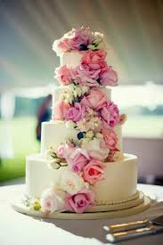 cascading flowers on 4 tier wedding cake with this cake