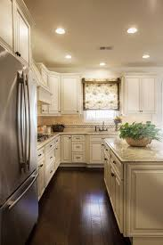 how to whitewash brown cabinets our top 5 antique white cabinet countertop pairings