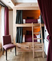 bedroom bunk beds with stairs and desk and slide sloped ceiling