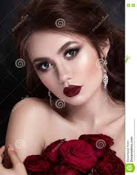 beauty fashion model portrait with red roses lips and nails
