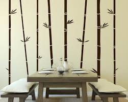black bamboo wall mural on brown painted wall and also cream painted wall along with black bamboo wall mural together with wooden table plus wooden bench