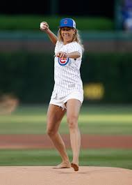 look barefoot olympian throws first pitch at wrigley field