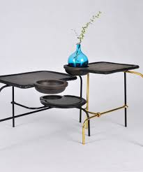 Coffee Table Uses by Chitapanya U0027s Compound Table Uses Intersecting Elements