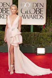 charlize theron plunging pink prom dress at golden globes