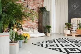 room with plants spacious modern living room with plants decor and red brick wall