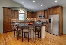 l shaped rustic kitchen with triangle island with seating kitchen