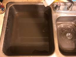 can you plunge a sink how to clear a clogged kitchen sink blue here now