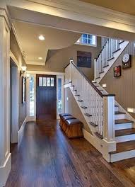 love all the colors the dark floors next to the white trim