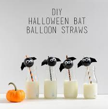 a pretty cool life diy halloween bat balloon straws