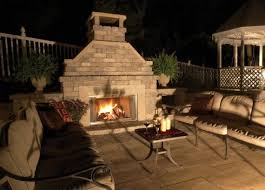 using natural stone in an outdoor fireplace and fire pit in