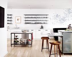 strip tease this ex beauty queen s sky high houston condo design in the kitchen stainless steel island shelves cabinet handles and cantilevered table