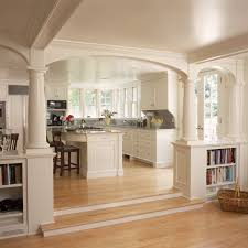 Archway In Traditional Kitchen Décor With Built In Shelves And