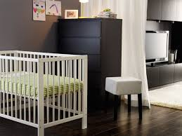 bedroom modern baby room design using white crib and green bedding