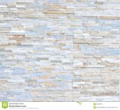 pattern of white modern stone brick wall surfaced stock photo