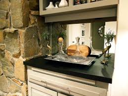 incridible stacked stone wall panels added white cabinetry shelves