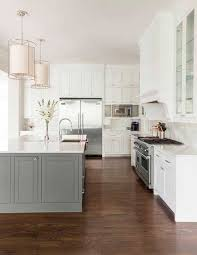 white kitchen cabinets with island 25 contrasting kitchen island ideas for a statement digsdigs