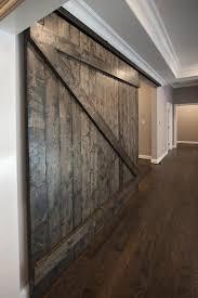custom oversized sliding barn door serving as optional divider for