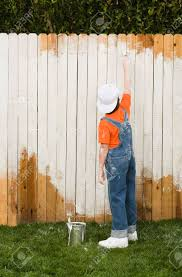 mixed race boy painting fence stock photo picture and royalty