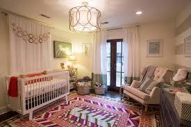 glider rocking chair nursery eclectic with dark wood floor
