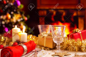 a romantic christmas dinner table setting with candles and
