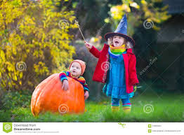 kids trick or treating at halloween stock photo image 57825091