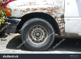 rusty car white background close old front wheel white rusty stock photo 711865552 shutterstock