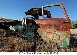 rusty pickup truck wreck of a rusty old pickup truck out in the field stock photo