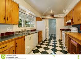white kitchen cabinets black tile floor narrow kitchen room interior with light brown cabinets