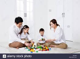 happy asian family with building blocks at home stock