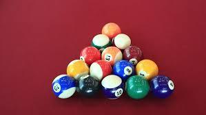 cue strikes pool balls on pool table rear view cu cu a cue