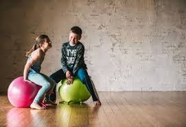 how sitting on a ball helps kids focus and do better in gaiam