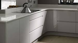 grey kitchen cupboards white granite sink floating rack and